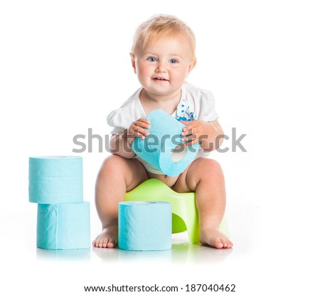 little baby sitting on a pot and keeps the toilet paper. studio photo isolated on white background