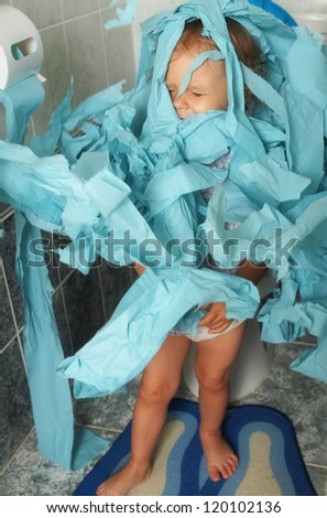 little baby sitting on the toiltete - stock photo