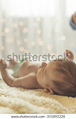 Little baby sleeping in nappy on blanket - stock photo