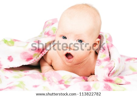 Little baby under multicolored towel