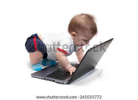 Little baby using laptop (notebook), isolated on white - stock photo