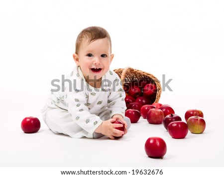 Little baby with apples on a white background - stock photo