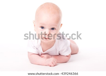 little baby with blue eyes on a white background