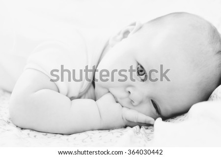little baby with finger in the mouth