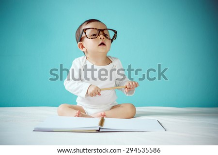 Little baby with Glasses - stock photo