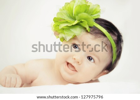 Little baby with green flower color - stock photo