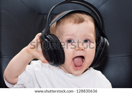 little baby with headphones