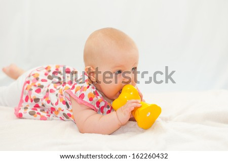 little baby with her toy - stock photo