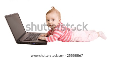 Little baby with laptop on white - stock photo