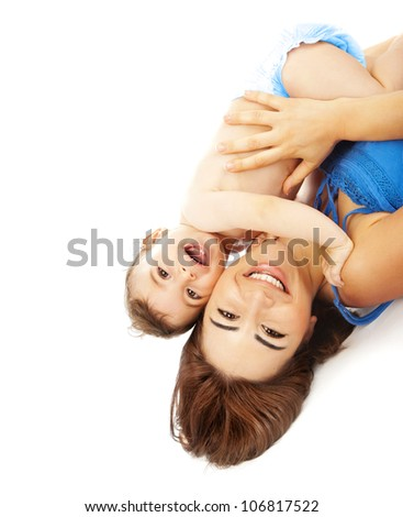 Little baby with mother isolated on white background, pretty woman and cute cheerful child play game, happy smiling young lady hugging son, adorable kid with mom lying down indoor, new family concept - stock photo