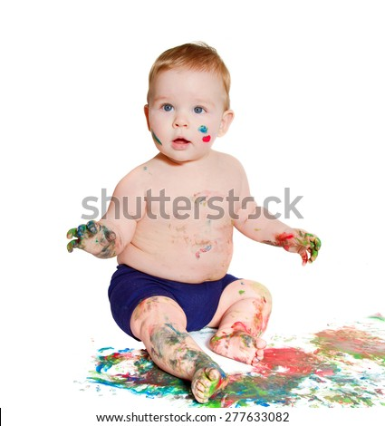 little baby wondering and playing with bright colors, getting messy hands and face. On white background - stock photo