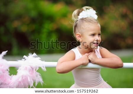 Little ballerina girl doing ballet bar exercises - stock photo
