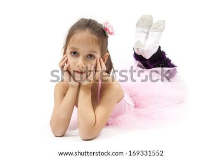 Little ballerina laying on floor. White background - stock photo