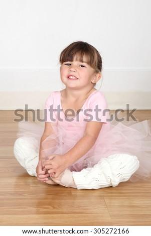 Little ballet girl dancing in the dance studio - stock photo