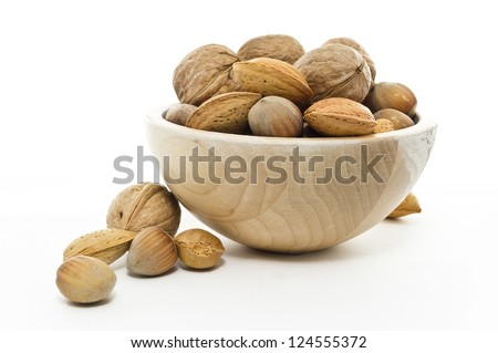 little basket nuts isolated in white background - stock photo