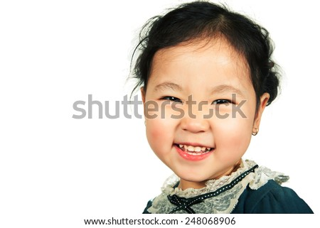 Little beautiful asian girl smiling, isolated on white background. Close-up. - stock photo
