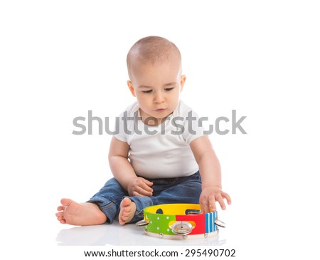 Little beautiful baby playing with tambourine isolated - stock photo