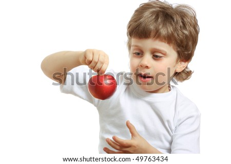 little beautiful child playing and eating an apple - isolated on white - stock photo