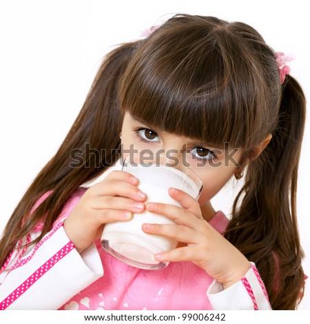 Little beautiful girl drinking milk - stock photo