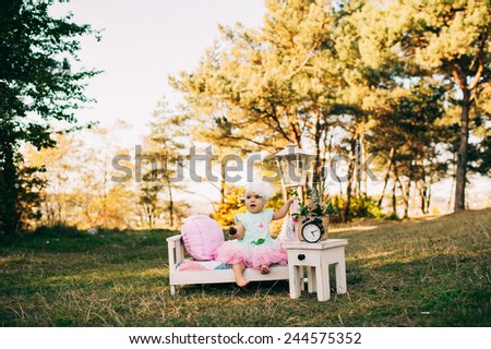 Little beautiful girl in park - stock photo