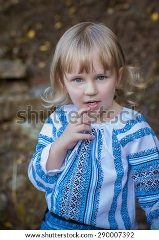 little beautiful girl in Ukrainian traditional ethnic costume - stock photo