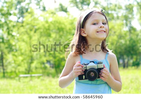 little beautiful happy girl with the camera