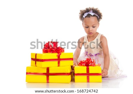 Little beautiful mulatto girl with gifts.