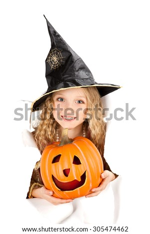 little beautiful witch with Jack O' Lantern peeking through a hole in white paper - stock photo