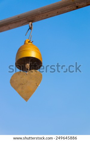 little bell with blue sky background - stock photo