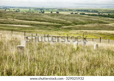 LITTLE BIGHORN, MT - JUNE 5, 2015: The cemetery is located near the battlefield at Little Bighorn in the Crow Agency. General George Custer's 7th Cavalry was defeated by the Lakota Sioux here in 1876. - stock photo