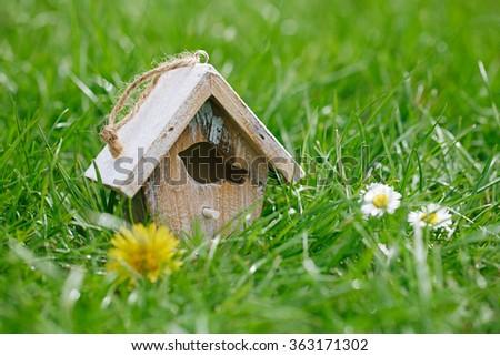 Little Birdhouse in Spring new grass - stock photo