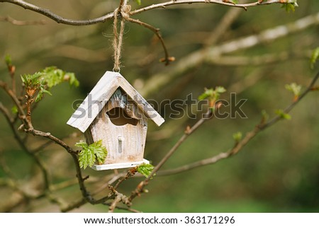 Little Birdhouse in Spring new leaves - stock photo