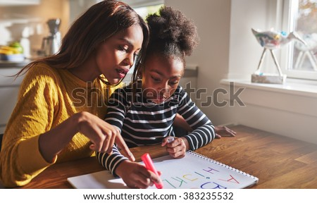 Little black girl learning to read learning the alphabet - stock photo