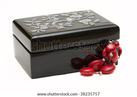 little black jewelery box  with red beads on white