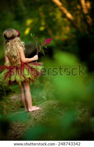 little blond fairy girl  in the forrest - stock photo