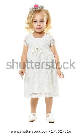 Little blond girl as a fairy princess, with magic wand and tiara, isolated on white background - stock photo