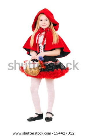 Little blond girl dressed as little red riding hood with basket. Isolated on white  - stock photo