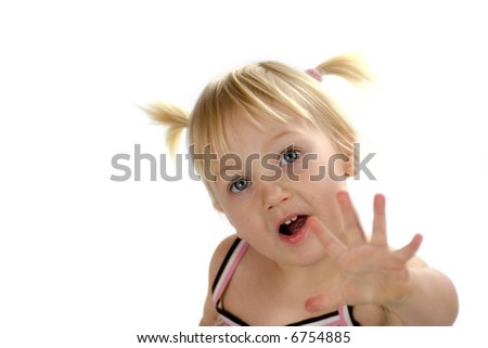 Little  blond girl looking up getting her dream with open palm isolated on white - stock photo