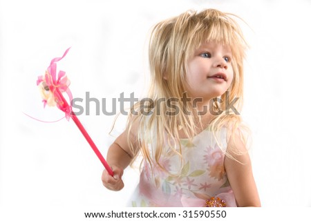 Little Blond Girl Playing with Pink Magic Wand