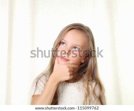 Little blond girl thinking touching her chin - stock photo