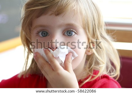 little blond girl tissue in nose - stock photo