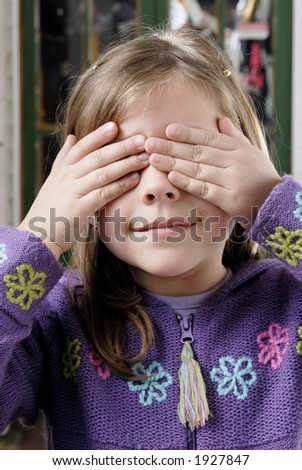 little blond girl wrapping their eyes herself - stock photo