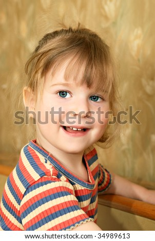 Little blond smiling girl (facial portrait) - stock photo