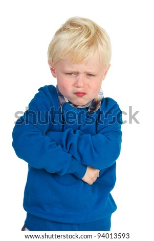 Little blond toddler is very angry