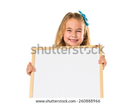Little blonde girl holding an empty placard  - stock photo