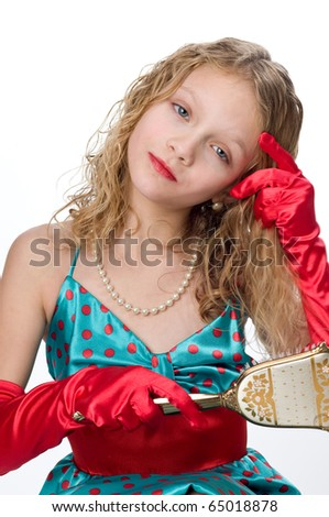 Little blonde girl playing dress up