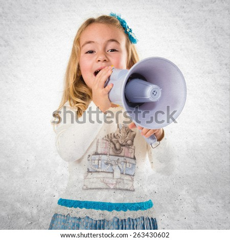 Little blonde girl shouting over textured background
