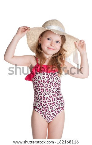 little blonde happy girl in pink swimsuit holding hat over white background - stock photo