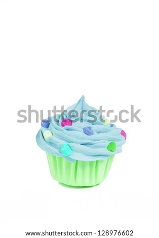 Little blue and green baby cupcake with confetti sprinkles isolated on a white background
