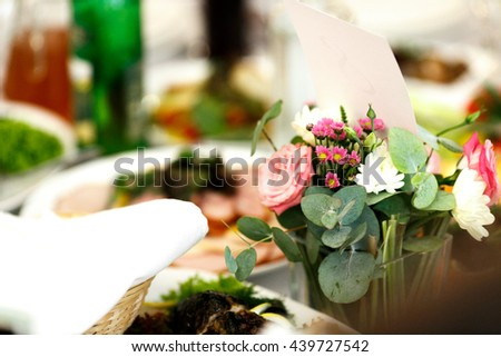 Little bouqets stand in vases with water on the table